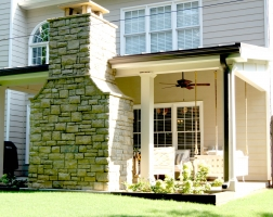 Covered Patio with Stacked Stone Fireplace