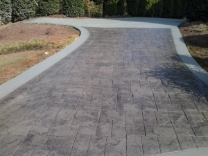 A stamped concrete driveway says, you have arrived Call the stamped concrete experts at ContractorMen 3580 Polly's Bluff Cumming, GA 30028 to add a professional stamped concrete finish to your driveway, sidewalk or patio.