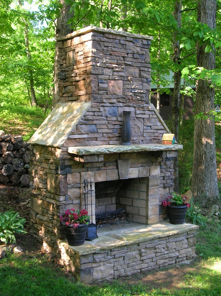 Build an outdoor fireplace with ContractorMen and enjoy the glow of a fire year round.